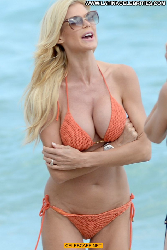 Victoria Silvstedt The Beach Celebrity Orange Posing Hot Beach Babe